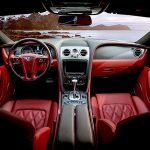 customised red car interior with red speakers