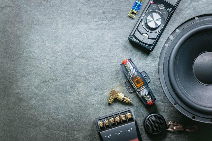 inline barrel fuse beside a speaker