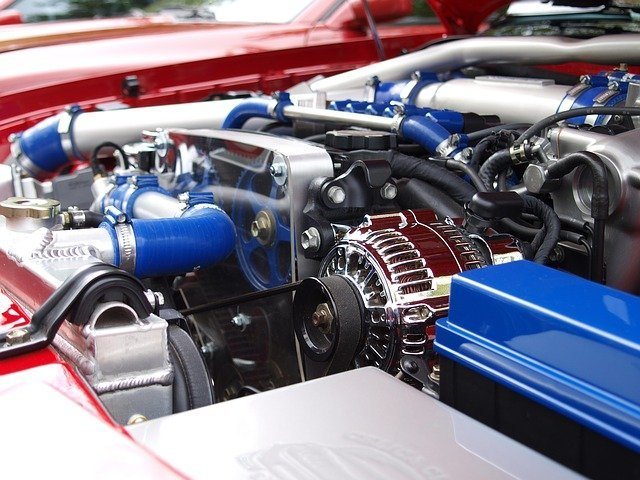 car alternator in engine bay causing whining noise